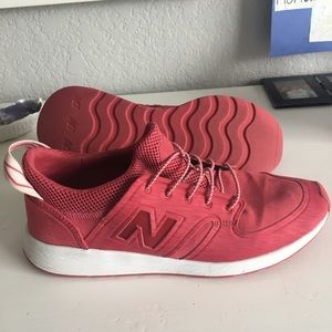 Red New Balance slip on sneakers